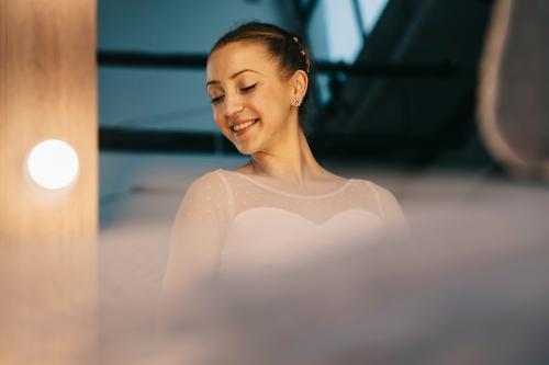 Elegant ballerina in white dress dancing in studio action adult attractive background balance ballet body choreography classic classical dance dancer elegance