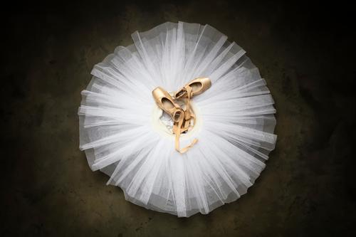 Ballet shoes with ribbons on a white tutu in a dance studio female dress ballerina beautiful love beauty happy atelier theater grace model actress pleasure work