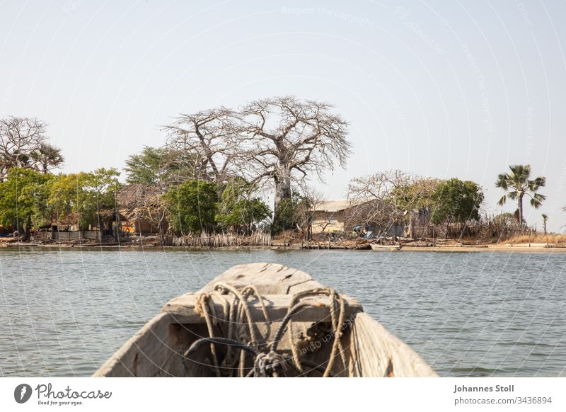 View from a wooden fishing boat on the island shore in an African landscape Fishing boat Pirogue Dugout wooden boat Navigation Fisherman Fishing (Angle) Anchor