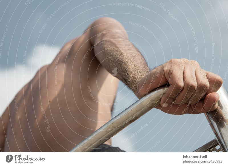 Male hand and upper body in front of a blue sky Hand arm Sand sandy Beach Lifeguard Lifesavers be afloat bathe Observe Sky Chair Chrome Hunting Blind lookout