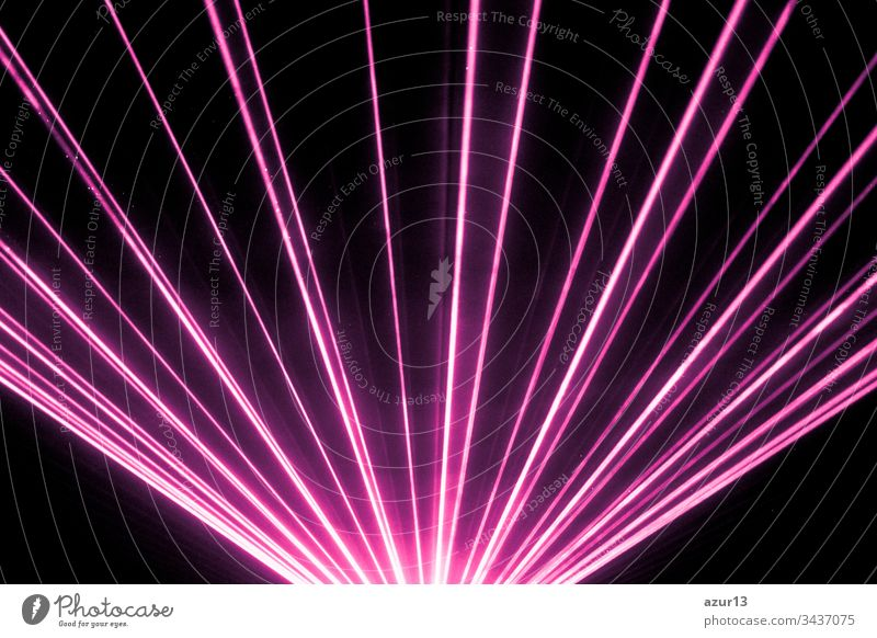 Pink laser show nightlife club stage and shining sparkling rays. Luxury entertainment in nightclub event, festival, concert or New Years Eve. Ray beams are symbol for science and universe research