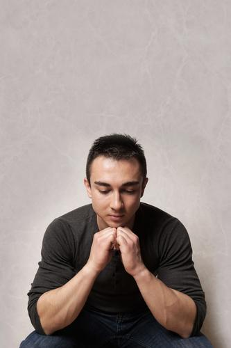 sad man looking down depression depressive disorder mood pensive depressed feeling pessimistic Melancholia Psychotic mental illness emotion young sadness crisis