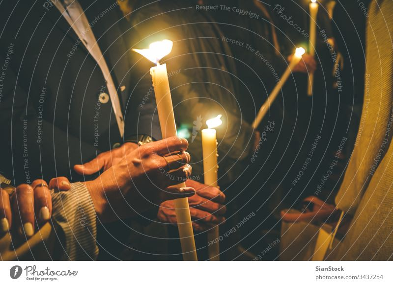 Woman holding a candle at night, during the Easter celebrations easter church candles orthodox religion christian light people prayer fire dark flame woman
