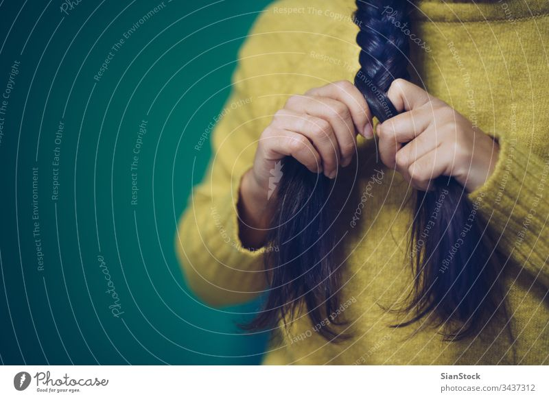 Girl is plaiting her hair braid woman braided beautiful girl brunette hairstyle green yellow portrait beauty braids young white fashion female face attractive
