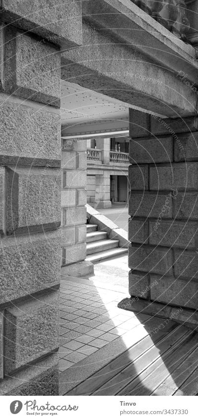 Passage in old masonry to a staircase and other parts of the building Wall (barrier) Building stone Stairs Balcony impressive Grand Old black-white pattern mix