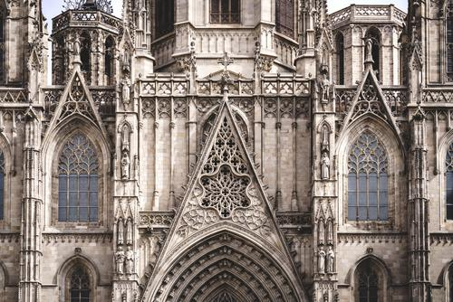 Rose window and sculpted filigrees at the front of a gothic cathedral Cathedral basilica architecture architectural built structure building history religion