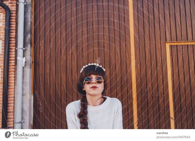 Young brunette woman with retro and hippy style pretty brown face naive hippie sweet young youht braid long hair outdoors tiara hairband cool trendy fresh