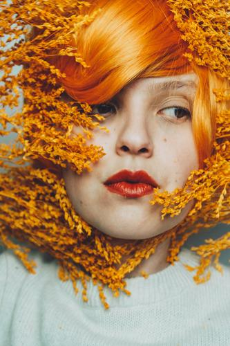 Moody portrait in orange tones of a white woman close up redhead redhair art artistic mood moody studio expression expressive beauty beauty photography