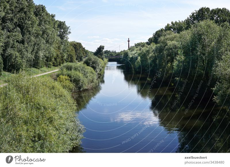river Leine at Hannover Germany hannover germany nature landscape lush scenic view scenery path green tree grass bridge water summer recreation outdoor
