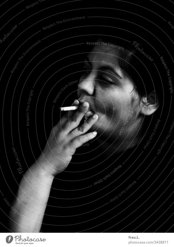 She had exchanged the unruly lighter, now the beauty could smoke whenever she wanted, and she did so with fervor. Woman Cigarette Feminine Face Smoking