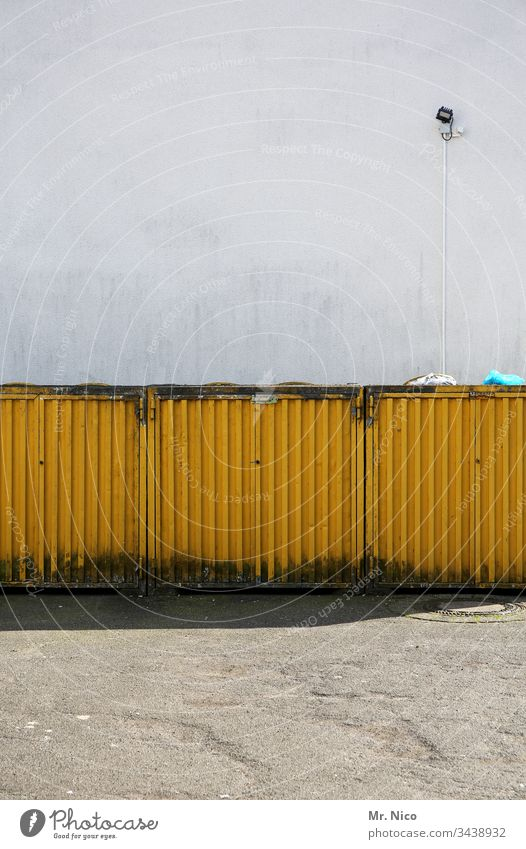 Waste container box garbage container Trash Trash container Yellow Container Recycling Dirty Environmental pollution Wall (building) Lamp Metal Refuse disposal
