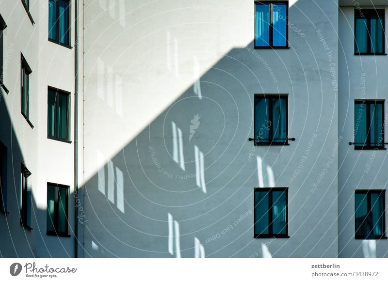 Light spots in the backyard on the outside Berlin Fire wall Germany Facade Window spring Spring Capital city House (Residential Structure) rear building