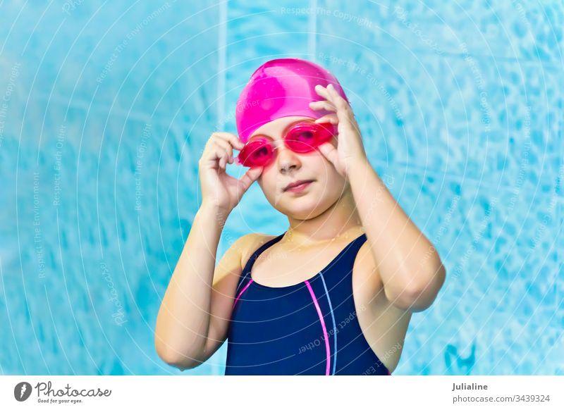 Cute girl in swimming pool child kid preschooler schoolgirl six seven white childhood Caucasian european water wet glare sport