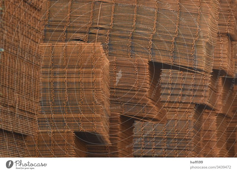 Stack of steel mats Grid Rust Industry Steel Old Metal Pattern Structures and shapes Detail Close-up Grating Industrial Abstract Grunge Consistency Deserted