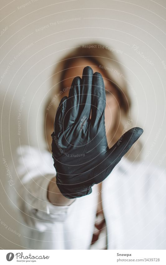 Woman Showing Stop Sign with Black Glove on glove Gloves black gloves rubber glove Doctor Scientist Blonde blond hair scrub covid-19 coronavirus Virus attention