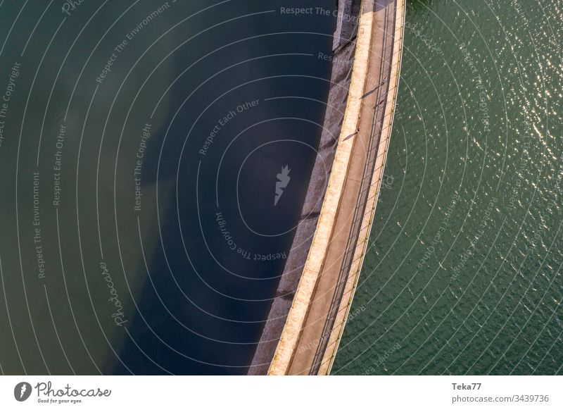 water dam from above big dam stone dam drinking water dam dam structure see dam wave lake waves wave texture aerial view background blue sun sunny drink water