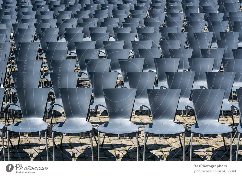 Open air theater empty seats. Rows of empty chairs outdoor abandoned aligned audience background blue city event festival chairs no people nobody open-air