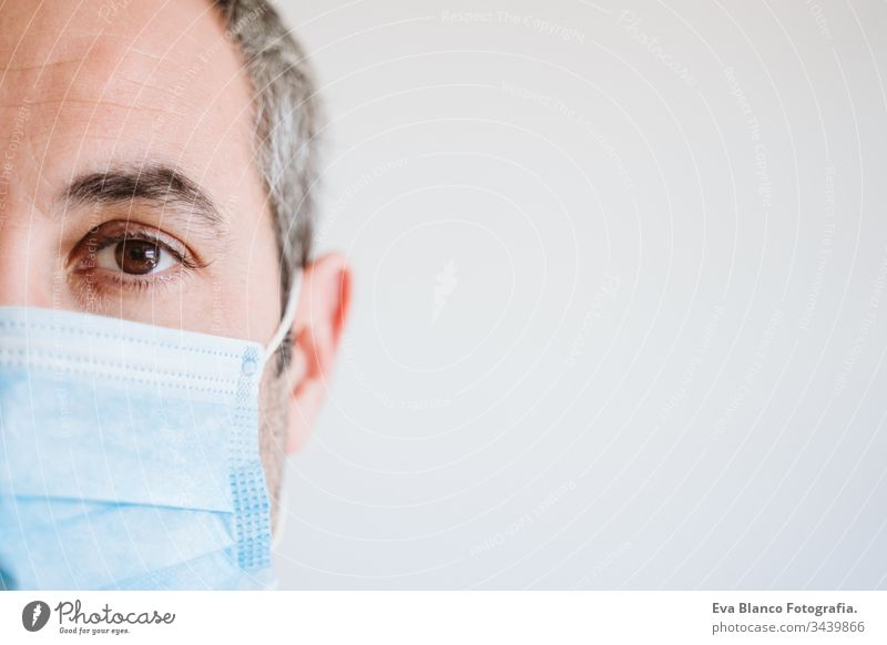 close up view of doctor man wearing protective mask and gloves indoors. Corona virus Covid-19 concept portrait professional corona virus hospital working