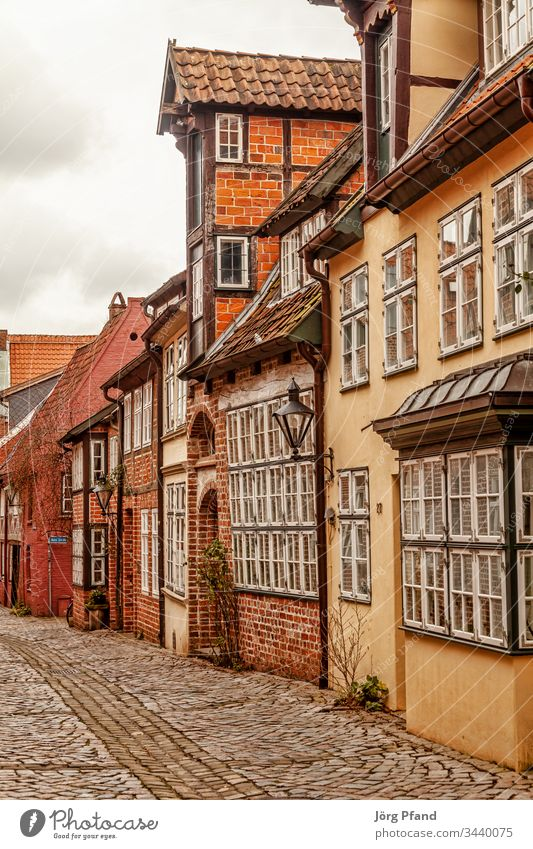 Street in Lüneburg old town Luneburg Germany Lower Saxony Old town houses Cobblestones Historic