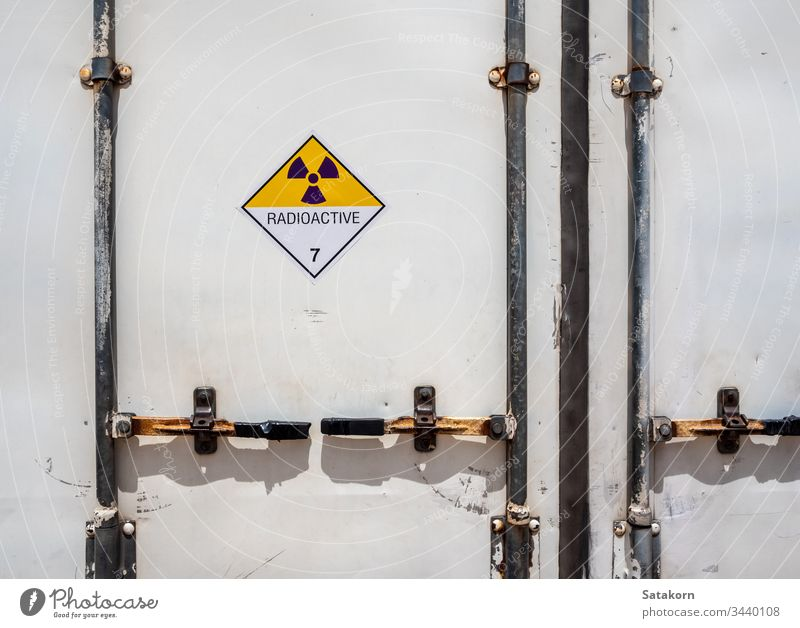 Radiation warning sign on the Dangerous goods transport label Class 7 at the container of transport truck hazmat radioactive transportation symbol aluminium