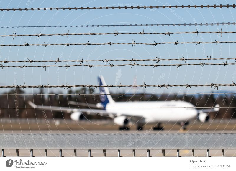 great break Airplane Barbed wire Fence Airport Barbed wire fence Aviation Exterior shot Deserted Airfield Vacation & Travel Tourism Flying Passenger plane