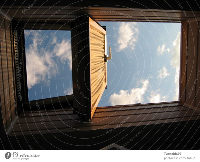 The Two Faces of Heaven Clouds Skylight Window Blue Exterior shot