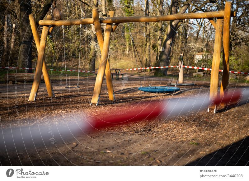 Playground ban - Corona Virus 2020 Playground prohibition corona Hall Germany covid19 output lock cordoned off barrier tape Red White Close-up Playing children