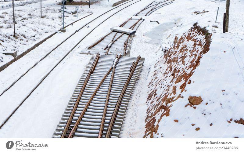 Snowy train tracks railway vanishing modern seasonal forward transport natural northern snowy direction freeze railroad frost transportation transit forest