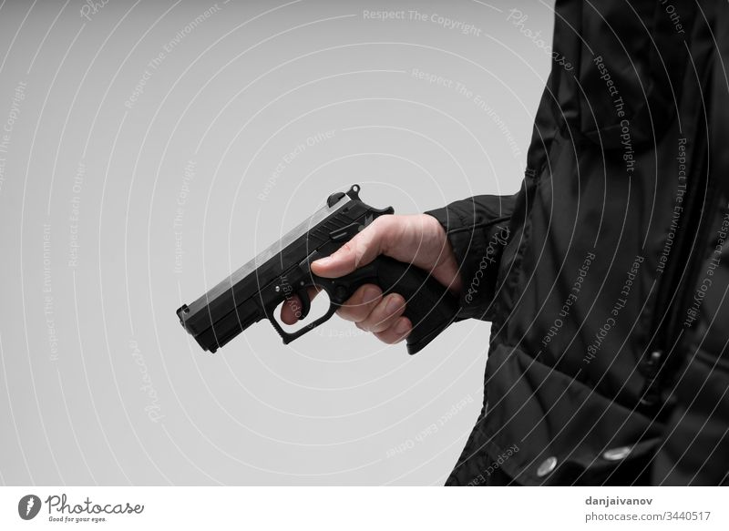Hand With Pistol on white background aggression aiming ak armed assault balaclava bandit black crime criminal dangerous firearm gangster gloves gun hand
