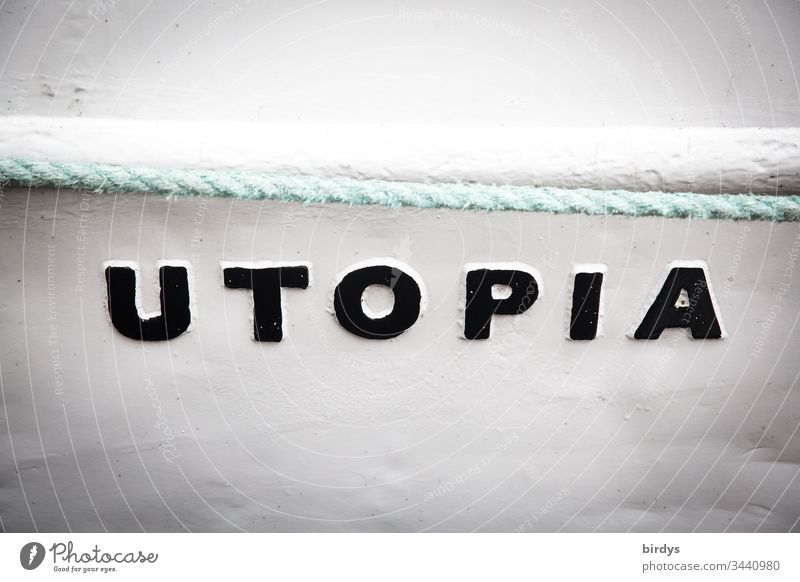 Utopia, writing on a boat, refers to a country where everyone is equally well off, an ideal state of affairs for everyone. Characters and letters Term