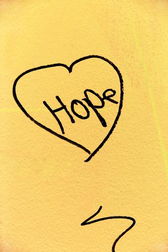 Hope, hope. A jewel on the wall of a house in difficult times of a pandemic, personal hardship, corona crisis or illness. Concern for survival combined with the comfort of hope and love. Heart as the source of