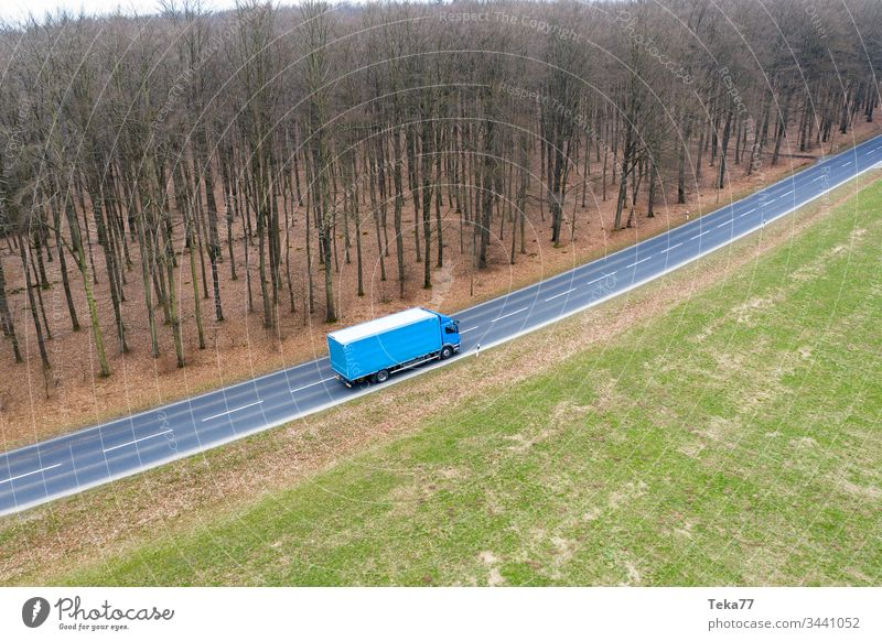 a truck on a country street from above modern truck truck transportation modern transportation street transportation street with a truck truck driving