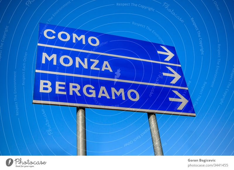 Cities direction italy street sign italian sky pole information signpost space ad panel board como city display advertising monca arrow announcement advertise