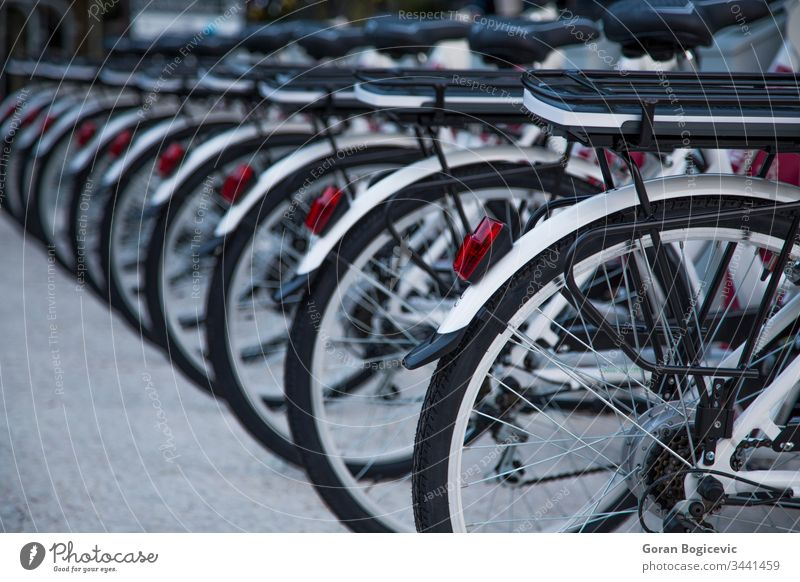 Public bicycles city wheel transport public urban row transportation bike ecology tire road alternative street traffic ride rent environmental group vehicle