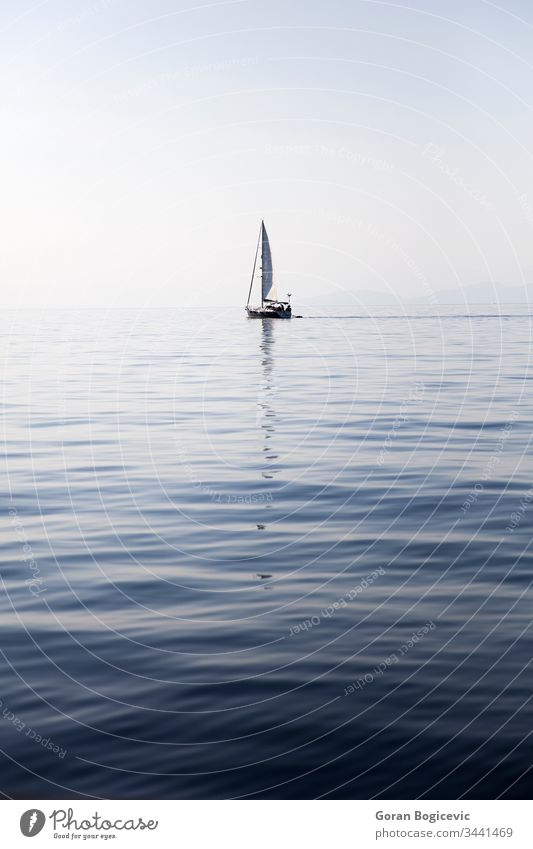 Sailing boat on a calm sea surface maritime mediterranean yachting outdoors day seascape marine wave travel sailboat nature water ocean tourism summer sport