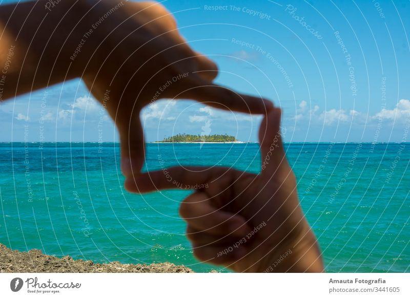 Seascape of Johnny Cay framed hand caribbean caribbean sea san andres colombia seven colors sea turquoise unique idyllic perfect beach shore coastline heart cay