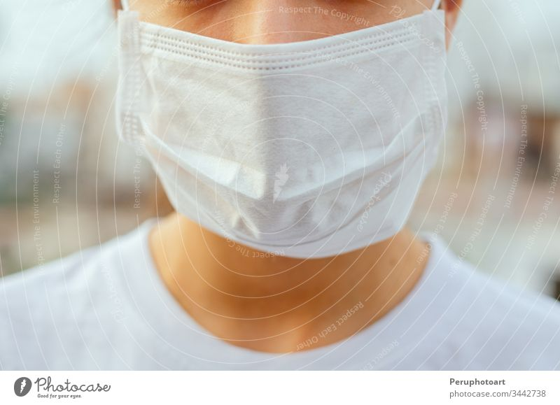 Closed face of a young woman where she is seen wearing a mask to avoid any contagion. Protection concept in times of pandemic pollution asian sick coronavirus