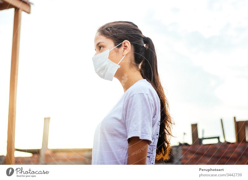 Young woman with a mask for protection against coronavirus COVID-19 on a sunny day young infection epidemic covid-19 adult illness female face portrait people