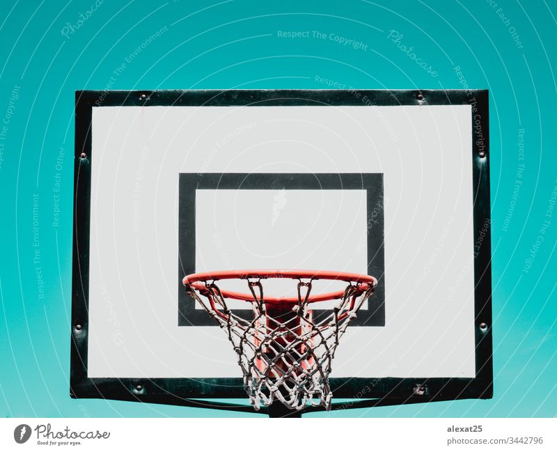 Basketball hoop on green background athletic backboard basket basketball circle competition court dunk equipment game indoor isolated net object play rim ring