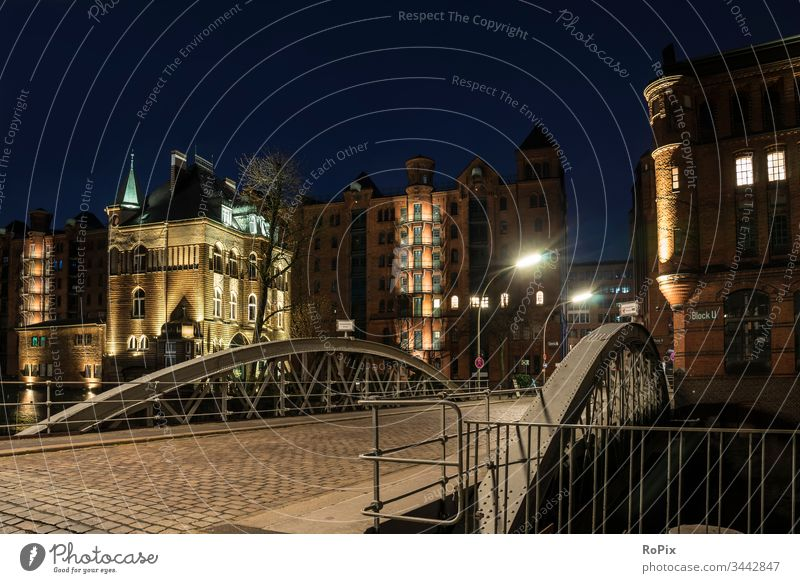 Night in Hamburg's warehouse district. storehouse city Harbour Depot Channel urban Elbe Bridge Building Architecture River Light Low tide canal locks Trade