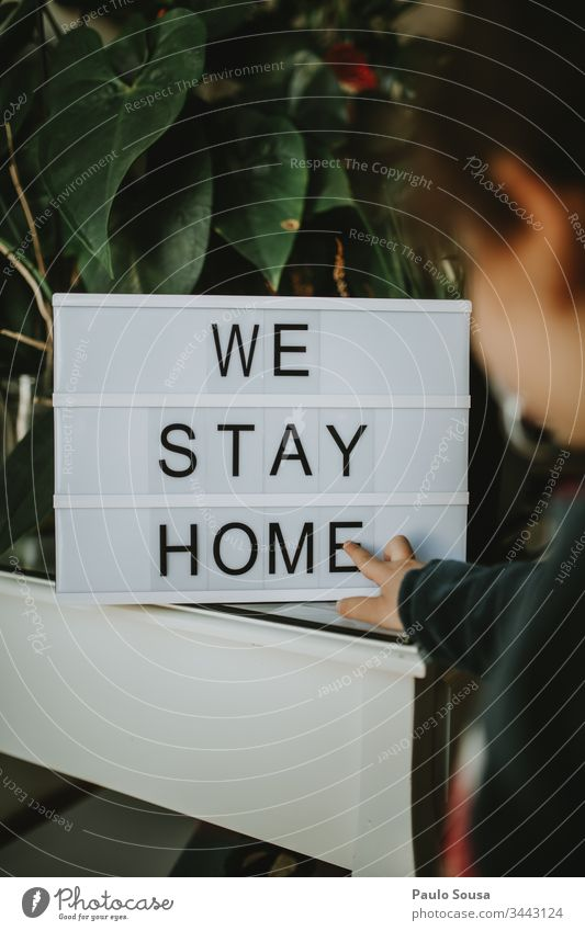 Child looks at message Stay at home stay at home Quarantine Quarantine period stay safe Home Lifestyle Lettering Copy Space Family & Relations Safety