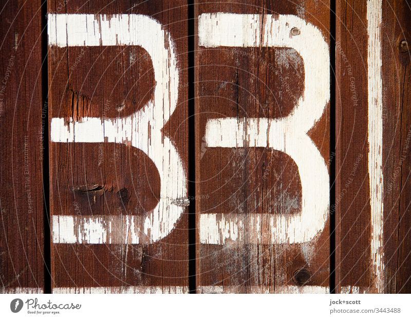 33 no more, no less Surface Ravages of time Signs and labeling Design Value Digits and numbers Typography Retro Simple Authentic Transience Change Weathered