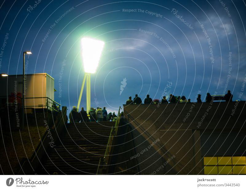 Encounter in the stadium in the spotlight Twilight Evening Stadium Fan chill tribune Floodlight Artificial light Light (Natural Phenomenon) Sporting event