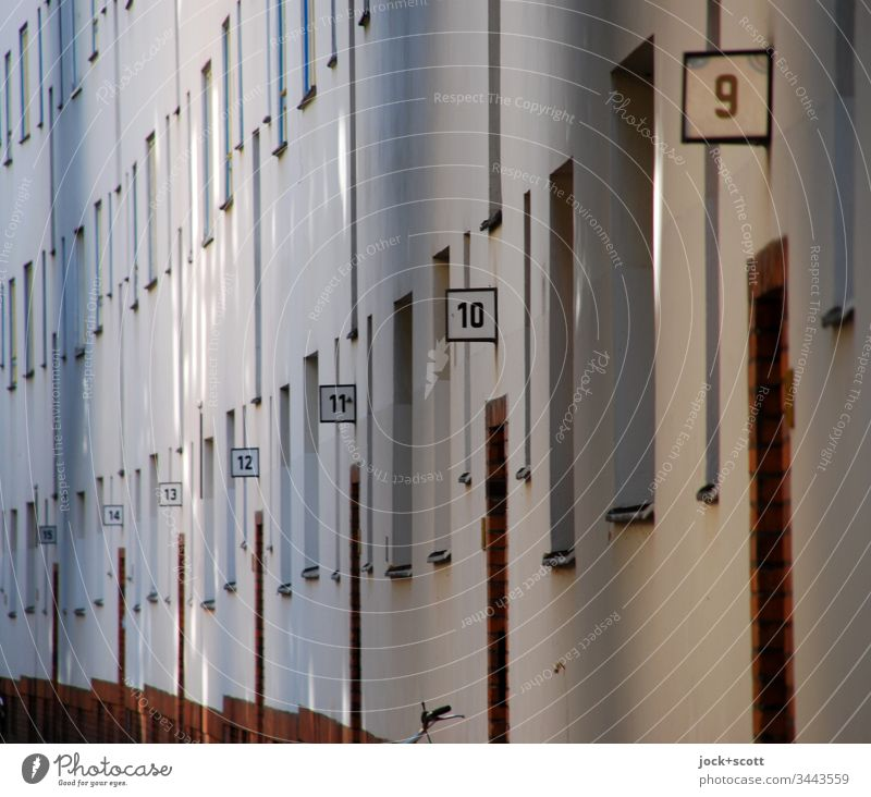 House numbers from 15 to 9 in one street Perspective Arrangement Digits and numbers Facade apartment building Architecture Row Sequence Signs and labeling