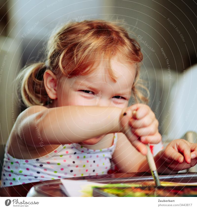 Little sweet girl shines and paints with watercolours Toddler Child Infancy Laughter luck Painting (action, artwork) Playing Joie de vivre (Vitality) Happiness
