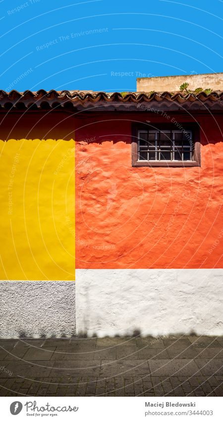 Colorful wall of a house. colorful building orange yellow background La Laguna city street Tenerife Spain architecture San Cristobal de La Laguna old town