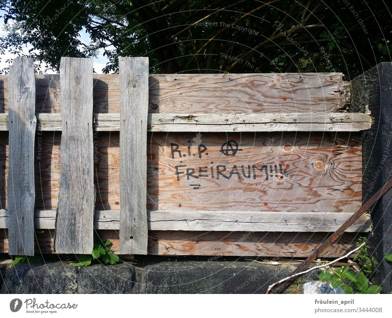 RIP Freiraum - lettering on a wooden fence containment cordon Closed board Fence Wooden fence Barrier Protection Bans Safety Characters Freedom Rebellious
