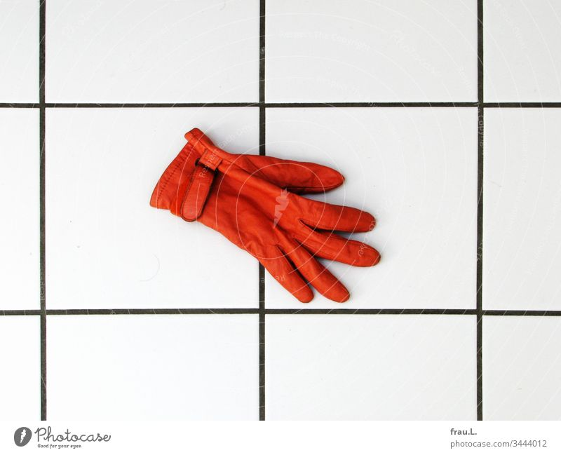 The orange glove froze on the cold tiles and he longed for his partner. bathroom floor Leather Interior shot Day Tile Deserted Living or residing