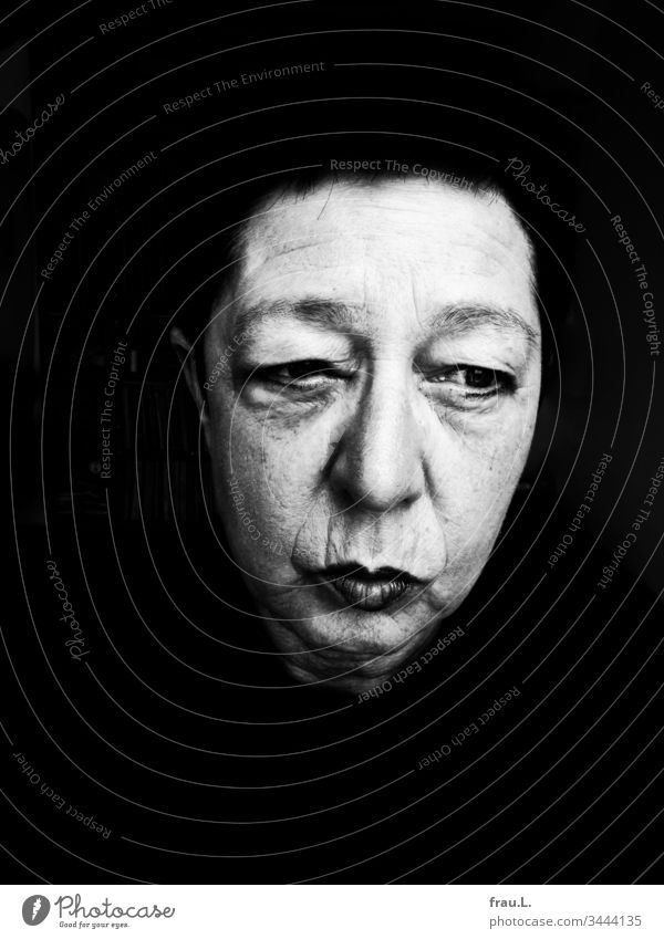 Something had gone wrong with the disinfectant that she had laboriously gotten hold of - her eyes, at least, were now quite swollen. Woman Portrait photograph
