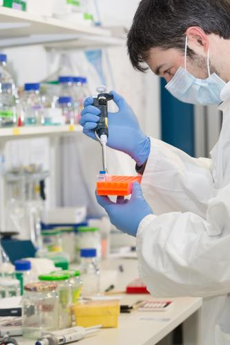 man pipetting in the laboratory dropper pipette analysis analyzing biological biotechnology care chemical chemist chemistry clinic corona coronavirus